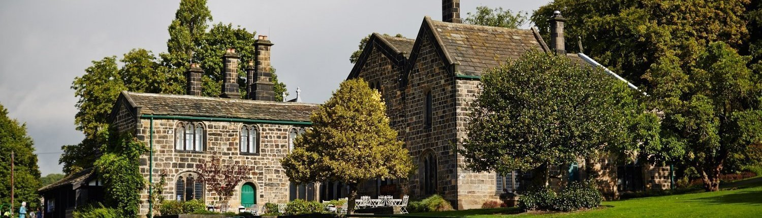 Abbey House Museum exterior with trees and gardens