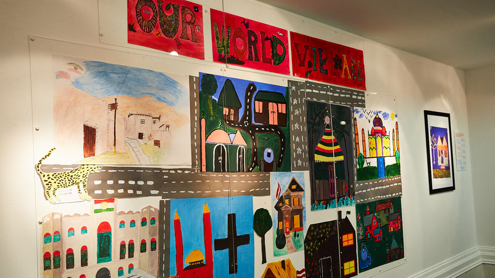 A wall filled with paintings made by recently arrived refugees who now live in Leeds