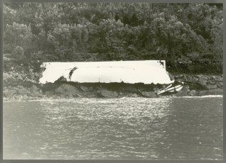 An upturned lifeboat on the eastern shore of Wellington Harbour after wreck of TEV Wahine.