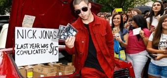Nick Jonas Selling CD Album in a Car Bagage