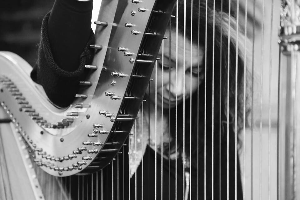 Harp Player in England
