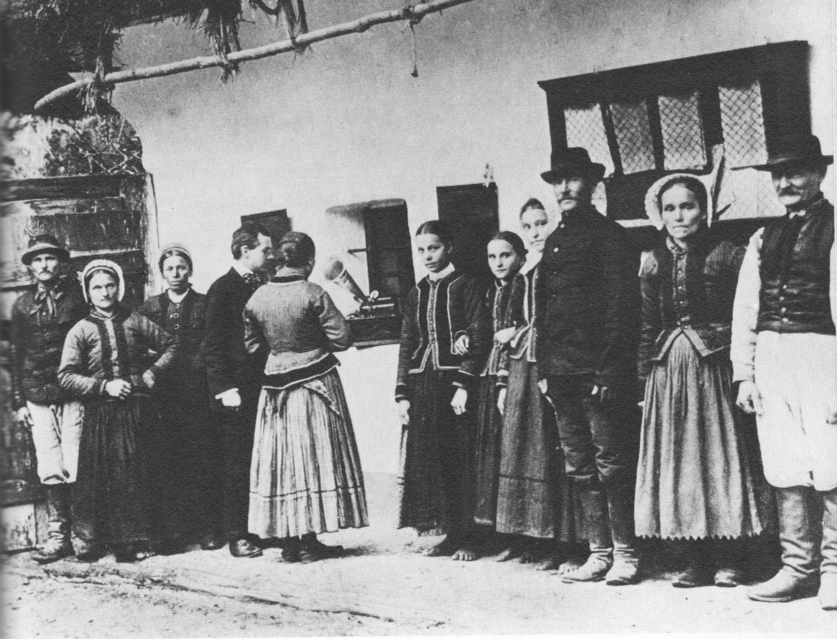 What is a folk song? Bela Bartok using a gramaphone to record folk songs sung by Slovak peasants.