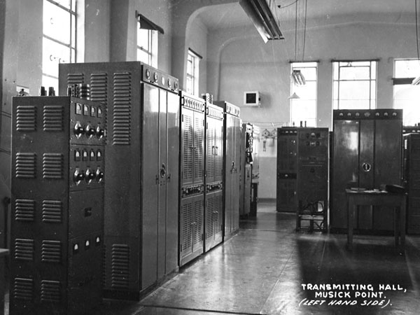 From left: A Collier & Beale transmitter which had an HF100 in the final. Next, what I think are a couple of STC 5KW transmitters used for radioteletype. There was a third one with a modulator that could be placed on the air/ground voice circuits if needed. That looks like part of the third STC in the middle of the floor. At the far end is what looks like another Collins (a 1KW and a 300W were there somewhere).