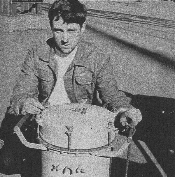 Roger Cliffe, radio officer of Gothic with the Marconi Salvita lifeboat radio he used after the ship's radio room was destroyed by fire