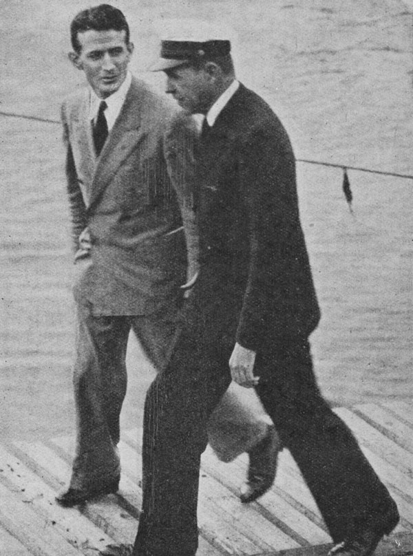 The day's responsibilities over, Mr H Gatty (left), the company's representative in New Zealand, with Captain Musick.