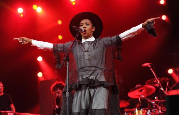 "Singer Lauryn Hill performs at Amnesty International's ""Bringing Human Rights Home"" Concert at the Barclays Center on Wednesday, Feb. 5, 2014 in New York. (Photo by Evan Agostini/Invision/AP)"