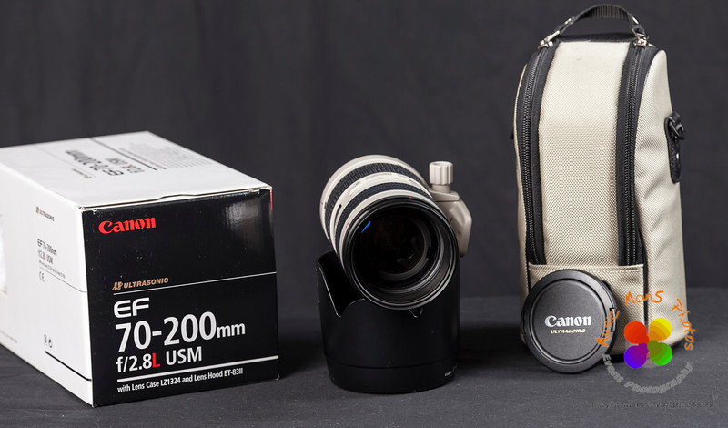 "For Sale: Canon EF 70-200mm f/2.8L USM $1,025 local pick up price, in mint condition (all caps, box & case).  Out of town price to be determined. I am only selling this lens because I replaced it with the Canon EF 28-300mm and just won't use it enough to keep it. Filter Size 77mmf/Stop Range 2.8-32Minimum Focus Distance 4.9'Magnification 1:7.7Zoom/Focus Control Two-touchAngle of View 30 to 12 DegreesGroups/Elements 15/18Tripod Collar YesLength 7.6""Maximum Diameter 3.3""Weight 2.80 lb"