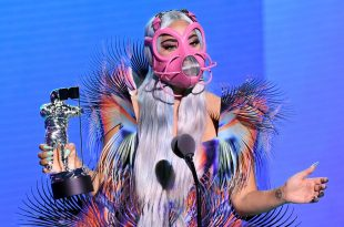 """Lady Gaga accepts the Best Collaboration award for """"Rain on Me"""" with Ariana Grande onstage during the 2020 MTV Video Music Awards, broadcast on Sunday, August 30th 2020. (Photo by Kevin Winter/MTV VMAs 2020/Getty Images for MTV)"""