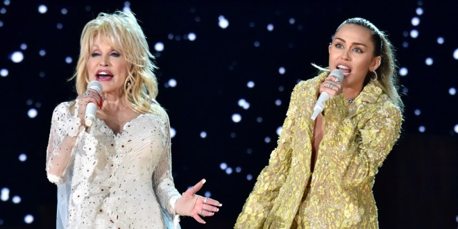 Dolly Parton and Miley Cyrus; Photo by Lester Cohen/Getty Images for The Recording Academy