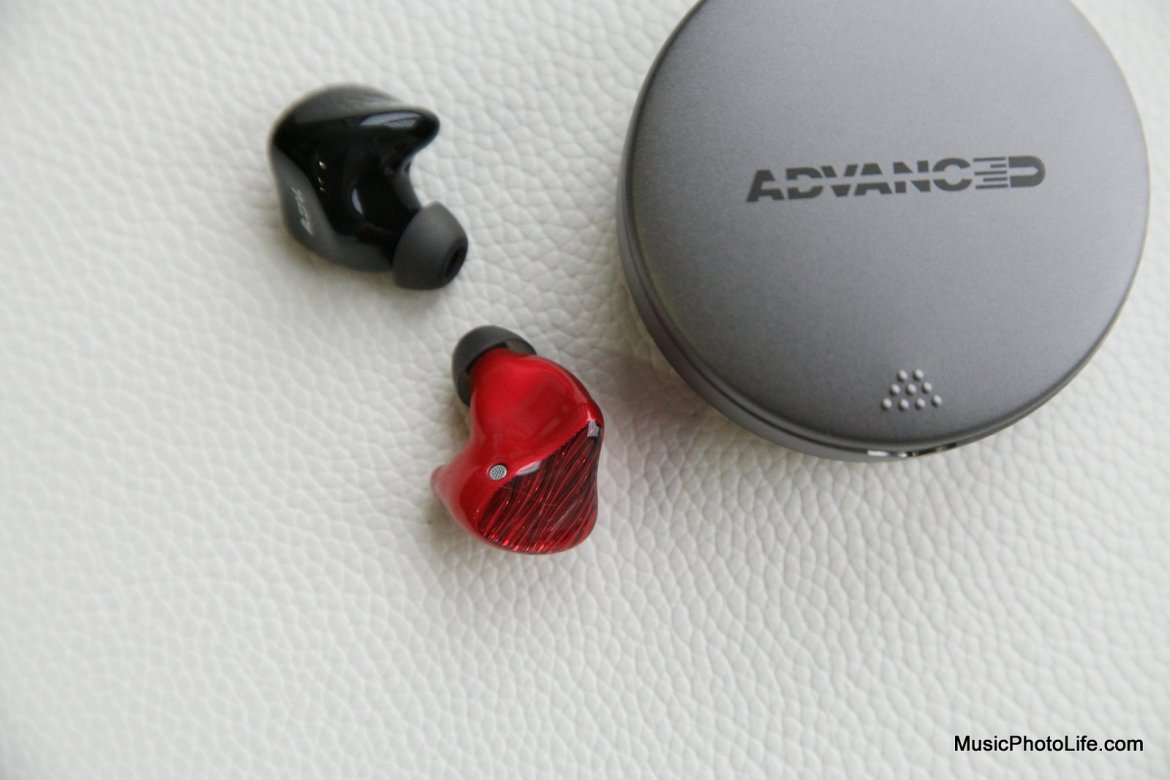 Advanced M5-TWS earbuds next to case