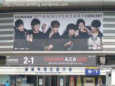 Huge poster for SHINHWA 15th Anniversary Concert on the Seoul Olympic Park Stadium façade.