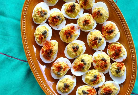 deviled eggs on a large serving platter