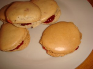 Lime and vanilla macarons, with raspberry jam