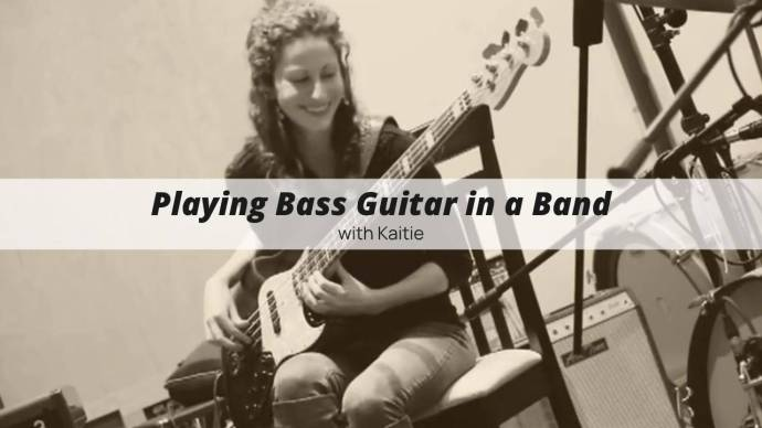 Playing bass guitar in a band with Kaitie