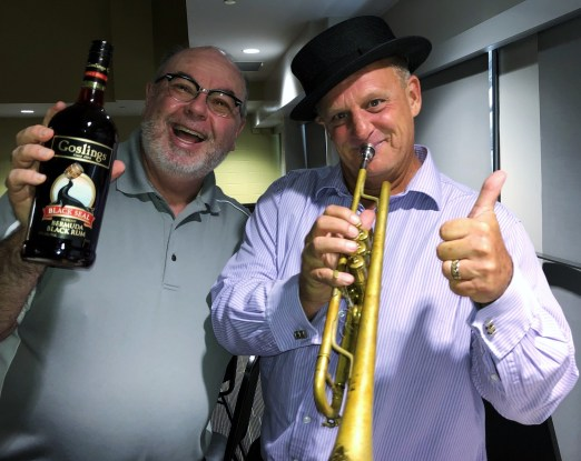 """Rotarian and """"at the post"""" bugler Mark Clairmont and host Nick Jones."""