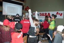 Members of Dara Howell's family cheer after watching her win gold in the ladies slopestyle ski event at the Olympics. A party was held at Hidden Valley Highlands Ski Area in Huntsville which saw over a hundred people gather to watch the event.
