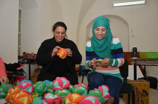 Shireen and Rahaf making puzzle balls for the CCF toy line