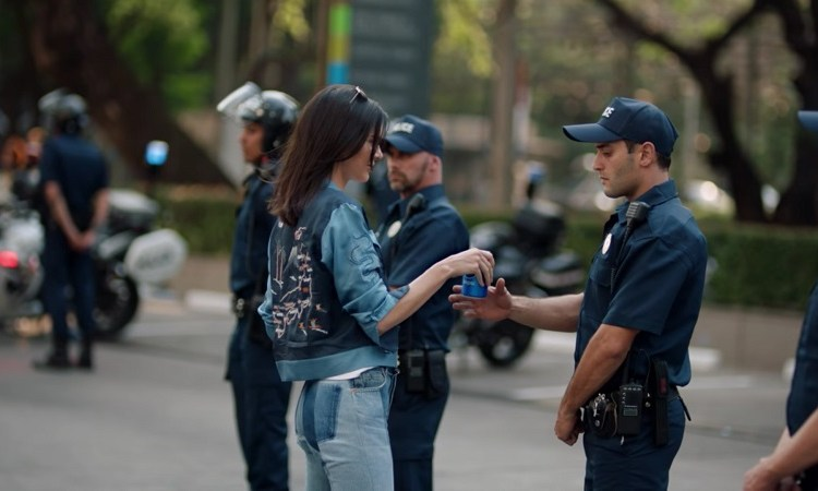 Why Is Kendall Jenner Offering Pepsi to the Police in a Protest?