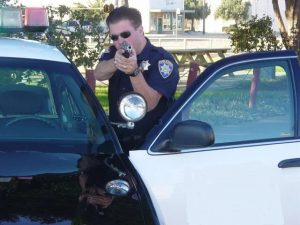 Cop with gun drawn