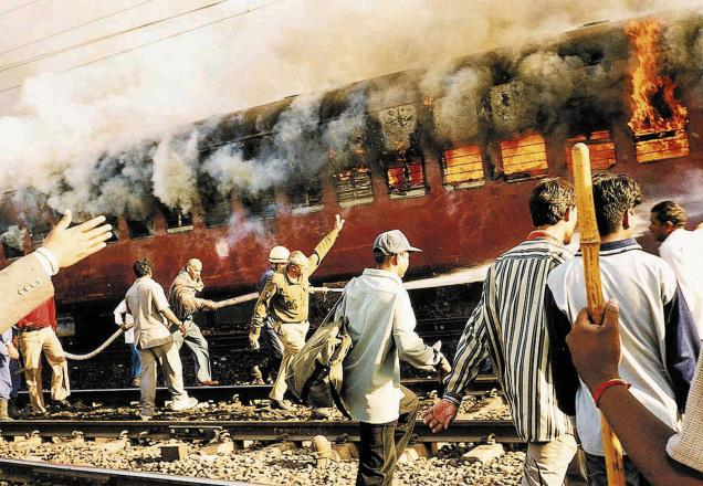 This February 27, 2002 photo shows the burning S-6 coach of the Sabarmati Express in Godhra.Photo credit  The Hindu