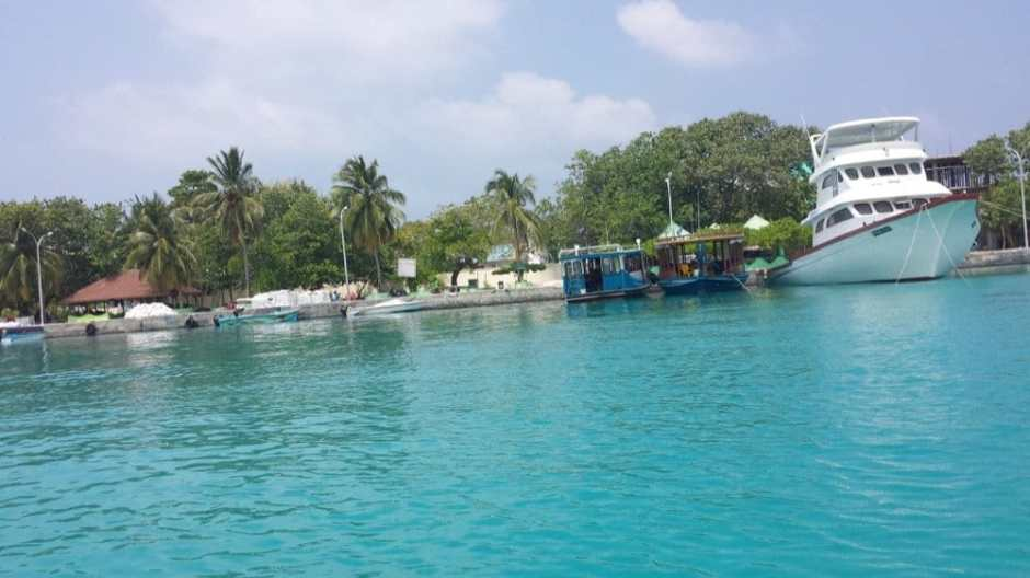 Muslim-Friendly Holiday in the Maldives on a budget | boat view of a local island in the maldives