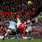 MANCHESTER, ENGLAND - FEBRUARY 12:  Wayne Rooney of Manchester United scores a goal from an overhead kick during the Barclays Premier League match between Manchester United and Manchester City at Old Trafford on February 12, 2011 in Manchester, England.  (Photo by Alex Livesey/Getty Images)