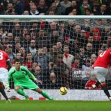 464760674-wayne-rooney-of-manchester-united-scores-the-gettyimages[1]