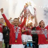 MANCHESTER, ENGLAND - MAY 13:  Ryan Giggs and Gary Neville of Manchester United celebrate winning the Barclays Premiership after the Barclays Premiership match between Manchester United and West Ham at Old Trafford on May 13 2007 in Manchester, England. (Photo by John Peters/Manchester United via Getty Images) *** Local Caption *** Ryan Giggs;Gary Neville