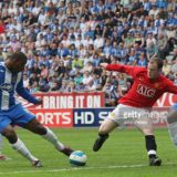 LONDON, ENGLAND - MAY 11:  Wayne Rooney of Manchester United clashes with Titus Bramble of Wigan Athletic during the Barclays FA Premier League match between Wigan Athletic and Manchester United at JJB Stadium on May 11 2008, in London, England. (Photo by John Peters/Manchester United via Getty Images)