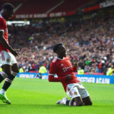 MANCHESTER, ENGLAND - JULY 28: Anthony Elanga of Manchester United celebrates after scoring their first goal during the pre-season friendly match between Manchester United and Brentford at Old Trafford on July 28, 2021 in Manchester, England. (Photo by Nathan Stirk/Getty Images)
