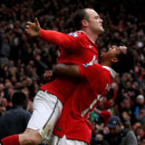 MANCHESTER, ENGLAND - FEBRUARY 12:  Wayne Rooney of Manchester United celebrates with teammate Nani (R) after he scores a goal from an overhead kick during the Barclays Premier League match between Manchester United and Manchester City at Old Trafford on February 12, 2011 in Manchester, England.  (Photo by Alex Livesey/Getty Images)