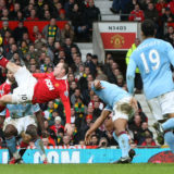 MANCHESTER, ENGLAND - FEBRUARY 12:  Wayne Rooney of Manchester United scores their second goal during the Barclays Premier League match between Manchester United and Manchester City at Old Trafford on February 12, 2011 in Manchester, England.  (Photo by Matthew Peters/Manchester United via Getty Images)