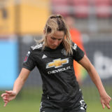 DAGENHAM, ENGLAND - OCTOBER 18: Abbie McManus of Manchester United runs with the ball during the Barclays FA Women's Super League match between West Ham United Women and Manchester United Women at Chigwell Construction Stadium on October 18, 2020 in Dagenham, England. (Photo by Kate McShane/Getty Images)