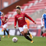 LEIGH, ENGLAND - JANUARY 24: Lauren James of Manchester United runs with the ball during the Barclays FA Women's Super League match between Manchester United Women and Birmingham City Women at Leigh Sports Village on January 24, 2021 in Leigh, England. Sporting stadiums around the UK remain under strict restrictions due to the Coronavirus Pandemic as Government social distancing laws prohibit fans inside venues resulting in games being played behind closed doors. (Photo by Charlotte Tattersall/Getty Images)