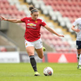 LEIGH, ENGLAND - MARCH 07: Kirsty Hanson of Manchester United scores their side's first goal during the Barclays FA Women's Super League match between Manchester United Women and Aston Villa Women at Leigh Sports Village on March 07, 2021 in Leigh, England. Sporting stadiums around the UK remain under strict restrictions due to the Coronavirus Pandemic as Government social distancing laws prohibit fans inside venues resulting in games being played behind closed doors. (Photo by Charlotte Tattersall/Getty Images)