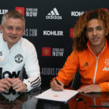 MANCHESTER, ENGLAND - MARCH 15: (EXCLUSIVE COVERAGE) Hannibal Mejbri of Manchester United poses with Manager Ole Gunnar Solskjaer after signing a new contract at Aon Training Complex on March 15, 2021 in Manchester, England. (Photo by Matthew Peters/Manchester United via Getty Images)