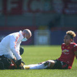 CRAWLEY, ENGLAND - APRIL 04: Lauren James of Man United gets medical attention before being substituted for an injury during the Barclays FA Women's Super League match between Brighton & Hove Albion Women and Manchester United Women at The Peoples Pension Stadium on April 04, 2021 in Crawley, England. Sporting stadiums around the UK remain under strict restrictions due to the Coronavirus Pandemic as Government social distancing laws prohibit fans inside venues resulting in games being played behind closed doors. (Photo by Charlie Crowhurst/Getty Images)