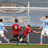 MANCHESTER, ENGLAND - APRIL 16: Samuel Edozie of Manchester City U23s scores their first goal during the Premier League 2 match between Manchester City U23s and Manchester United U23s at Manchester City Football Academy on April 16, 2021 in Manchester, England. (Photo by John Peters/Manchester United via Getty Images)
