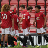 LEIGH, ENGLAND - APRIL 23: Shola Shoretire of Manchester United U23s celebrates scoring their second goall during the Premier League 2 match between Manchester United U23s and Chelsea U23s at Leigh Sports Village on April 23, 2021 in Leigh, England. (Photo by Tom Purslow/Manchester United via Getty Images)