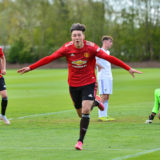 LEEDS, ENGLAND - MAY 01: Charlie McNeill of Manchester United U18s celebrates scoring their second goal during the U18 Premier League match between Leeds United U18s and Manchester United U18s at LU Academy on May 01, 2021 in Leeds, England. (Photo by Manchester United/Manchester United via Getty Images)