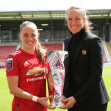 LEIGH, ENGLAND - MAY 16: Ona Batlle of Manchester United Women poses with Manager Casey Stoney and her Player of the Season trophy ahead of the Vitality Women's FA Cup 5th Round match between Manchester United Women and Leicester City Women at Leigh Sports Village on May 16, 2021 in Leigh, England. Sporting stadiums around the UK remain under strict restrictions due to the Coronavirus Pandemic as Government social distancing laws prohibit fans inside venues resulting in games being played behind closed doors.  (Photo by John Peters/Manchester United via Getty Images)