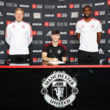 MANCHESTER, ENGLAND - JULY 26: Charlie McNeill of Manchester United poses after signing a new contract with the club at Carrington Training Ground on July 26, 2021 in Manchester, England. (Photo by Ash Donelon/Manchester United via Getty Images)