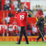 MANCHESTER, ENGLAND - AUGUST 14: New signing, Raphael Varane of Manchester United is introduced to fans on the pitch prior to the Premier League match between Manchester United  and  Leeds United at Old Trafford on August 14, 2021 in Manchester, England. (Photo by Catherine Ivill/Getty Images,)