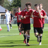 LEEDS, ENGLAND - AUGUST 28: Daniel Gore of Manchester United U18s celebrates scoring their first goal during the U18s Premier League match between Leeds United U18s and Manchester United U18s at Thorp Arch Training Ground on August 28, 2021 in Leeds, England. (Photo by John Peters/Manchester United via Getty Images)