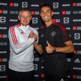 MANCHESTER, ENGLAND - SEPTEMBER 08: (EXCLUSIVE COVERAGE) Cristiano Ronaldo of Manchester United poses with Manager Ole Gunnar Solskjaer after signing his contract with the club at Carrington Training Ground on September 08, 2021 in Manchester, England. (Photo by Ash Donelon/Manchester United via Getty Images)