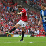MANCHESTER, ENGLAND - SEPTEMBER 15:  Nick Powell of Manchester United scores the fourth goal during the Barclays Premier League match between Manchester United and Wigan Athletic at Old Trafford on September 15, 2012 in Manchester, England.  (Photo by Alex Livesey/Getty Images)