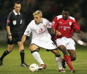 CREWE, ENGLAND - OCTOBER 26:  Alan Smith of Manchester United (L) clashes with Justin Cochrane of Crewe Alexandra during the Carling Cup match between Crewe Alexandra and Manchester United at Alexandra Stadium on October 26 2004 in Crewe, England. (Photo by Matthew Peters/Manchester United via Getty Images)