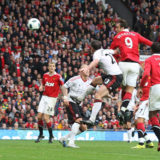 MANCHESTER, ENGLAND - SEPTEMBER 19: Dimitar Berbatov of Manchester United scores their third goal during the Barclays Premier League match between Manchester United and Liverpool at Old Trafford on September 19, 2010 in Manchester, England.  (Photo by Matthew Peters/Manchester United via Getty Images)
