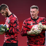 MANCHESTER, ENGLAND - JANUARY 24: Dean Henderson of Manchester United warms up with team mate David De Gea (L) ahead of The Emirates FA Cup Fourth Round match between Manchester United and Liverpool at Old Trafford on January 24, 2021 in Manchester, England. Sporting stadiums around the UK remain under strict restrictions due to the Coronavirus Pandemic as Government social distancing laws prohibit fans inside venues resulting in games being played behind closed doors. (Photo by Laurence Griffiths/Getty Images)