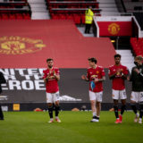MANCHESTER, ENGLAND - MAY 18:   Manchester United Head Coach / Manager Ole Gunnar Solskjaer and the players applaud the fans at the end of the Premier League match between Manchester United and Fulham at Old Trafford on May 18, 2021 in Manchester, United Kingdom. (Photo by Ash Donelon/Manchester United via Getty Images)